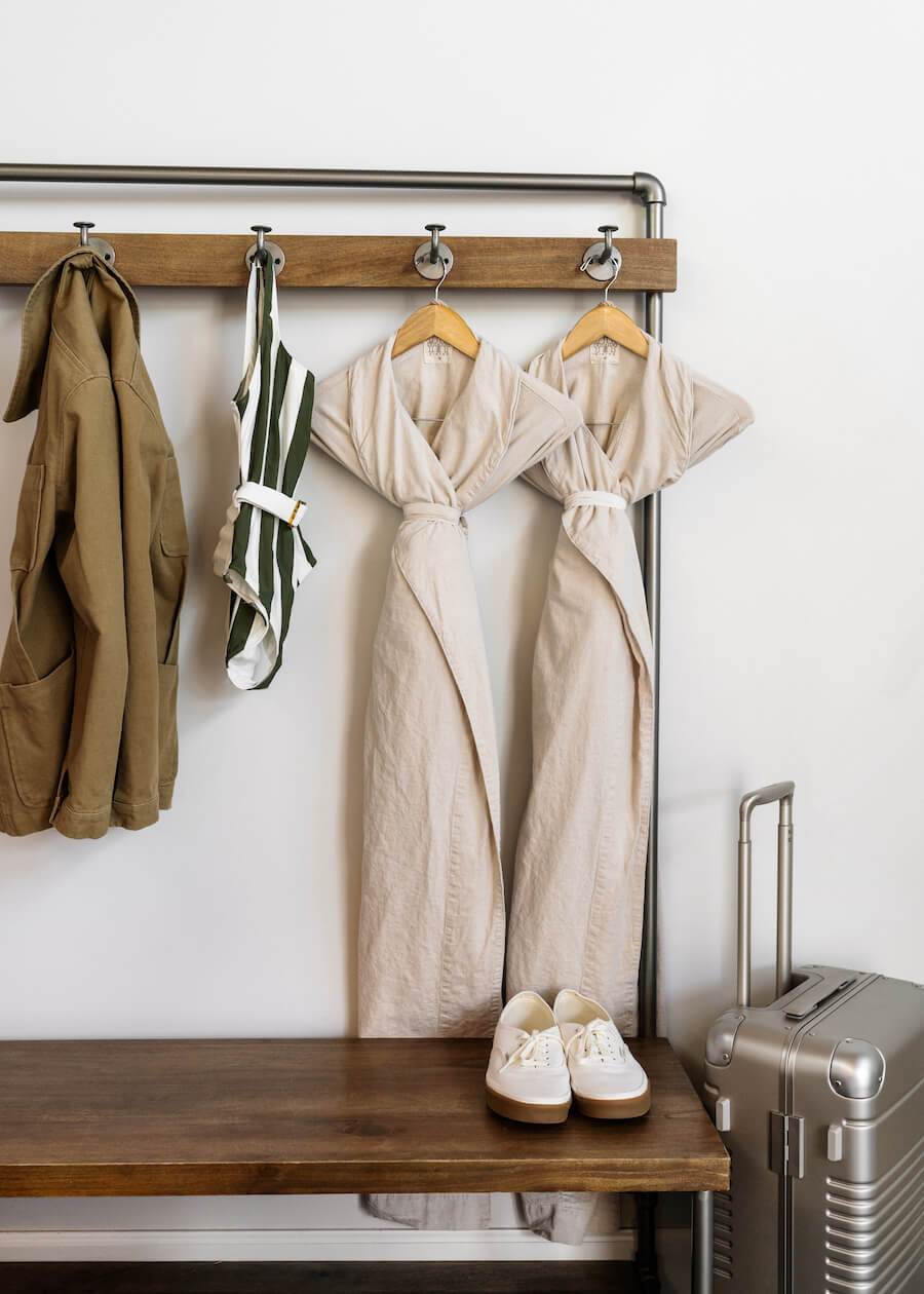 robes and swimsuit hanging on guest room rack