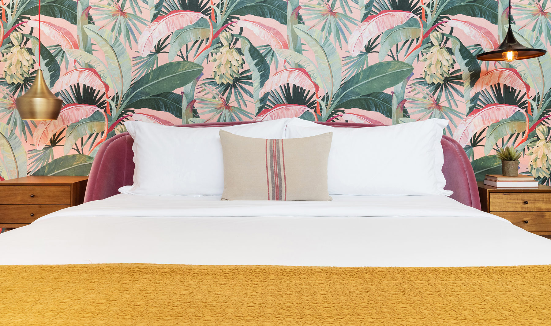 ARRIVE Palm Springs guest room bed with palm wallpaper